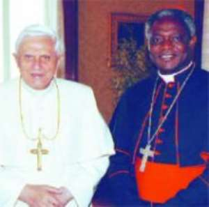 Cardinal Appiah Turkson in a pose with Pope Benedict XIV