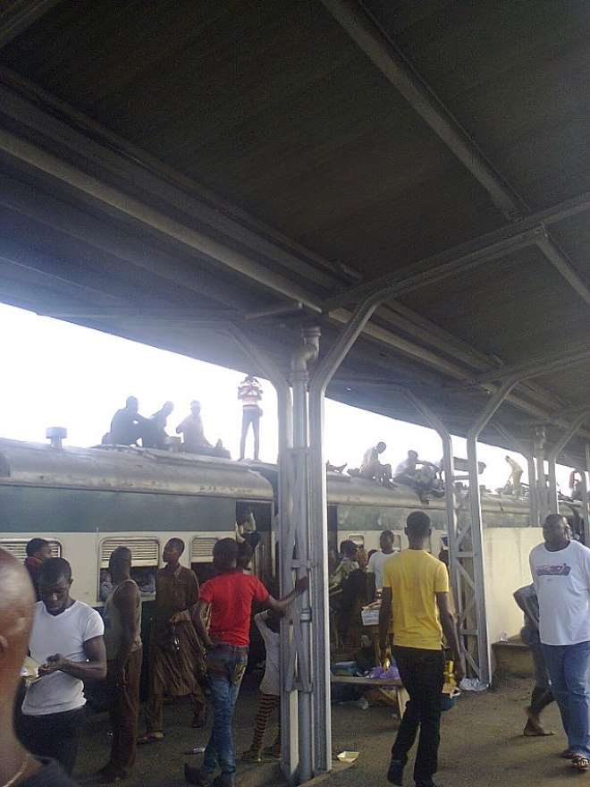RAILWAY PASSENGERS FROM ILORIN ON TOP OF THE TRAIN AT OSOGBO TERMINAL