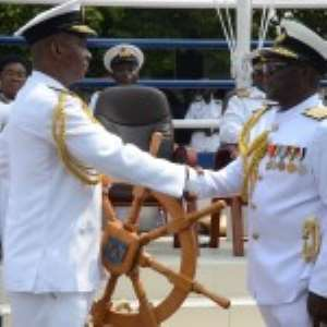 Real Admiral Geoffery Mawuli Biekro (right), handing over the staff of to Commodore Peter Faidoo the new Chief Naval Staff