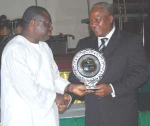 Vice president Mahama presenting top position award to an official of Stanbic.