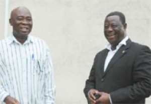 Mr Amoako Atta (left) and Mr Atta Twum NPP and NDC candidates for Atiwa Constituency in a hearty chat.