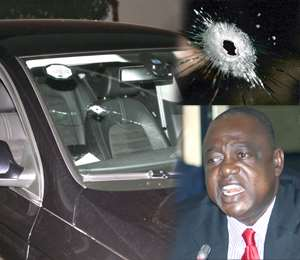 Dr Kunbuor (right) and his bullet ridden car