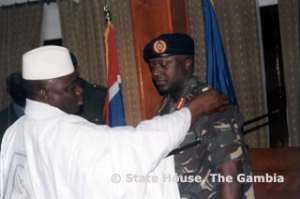 Better Days: President Yahya Jammeh decorates his former ally Lt. General Tamba