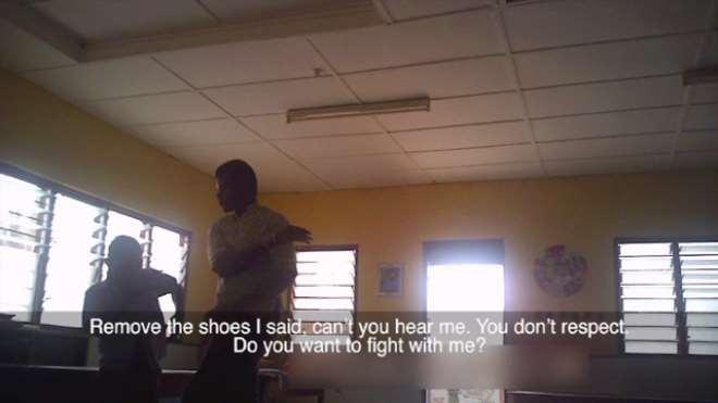 TEACHER SLAPPING BOY