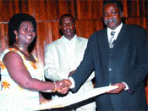 Prof. Daniel Buor (right), Provost of CASS receiving his award from Mrs Vesta Adu Gyemfi.