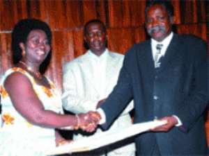 Prof. Daniel Buor (right), Provost of CASS receiving his award from Mrs Vesta Adu Gyemfi.