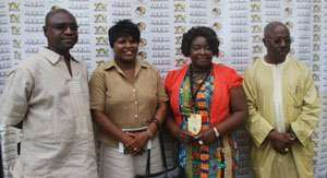Kwaw Ansah (right) with Prof Linus Abraham of NAFTI and others