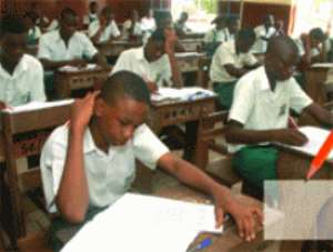 Students writing a WAEC examination.