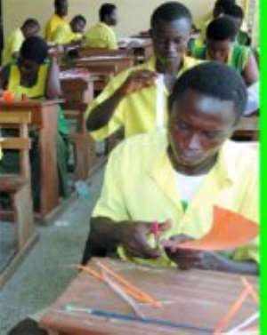 Students of Ebenezer Senior High School take their turn in the ongoing West African Senior School Certficate Examination practicals.