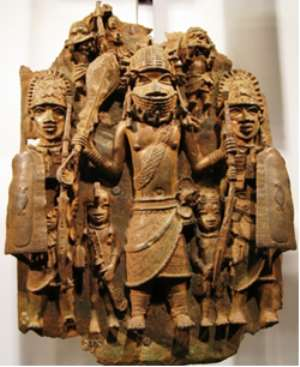 Warrior flanked by two shield bearers, Benin, Nigeria, now in British Museum, London.