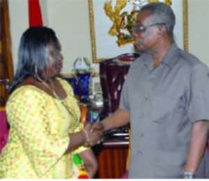 President Mills congratulating Mrs Beatrice Rosa Brobbey after she had been sworn in as Ghana's Ambassador to Guinea