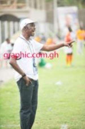Coach J. E. Sarpong