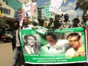 Youths in Kenya protest the murder of Muammar Gaddafi by NATO