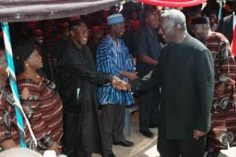 President J.A Kufuor in a warm and lively handshake with his political opponent, Dr Obed Asamoah of the DFP.<br/>Source: GNA