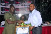 2014 Grand Ball Presents Cheques to AMWeF & Musiga Academy
