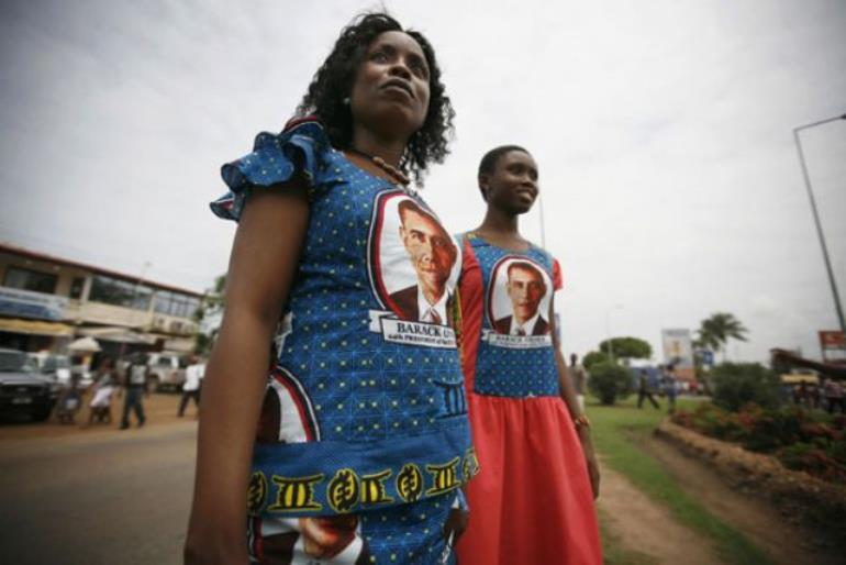Ghanaian women in dresses featuring Obama's picture