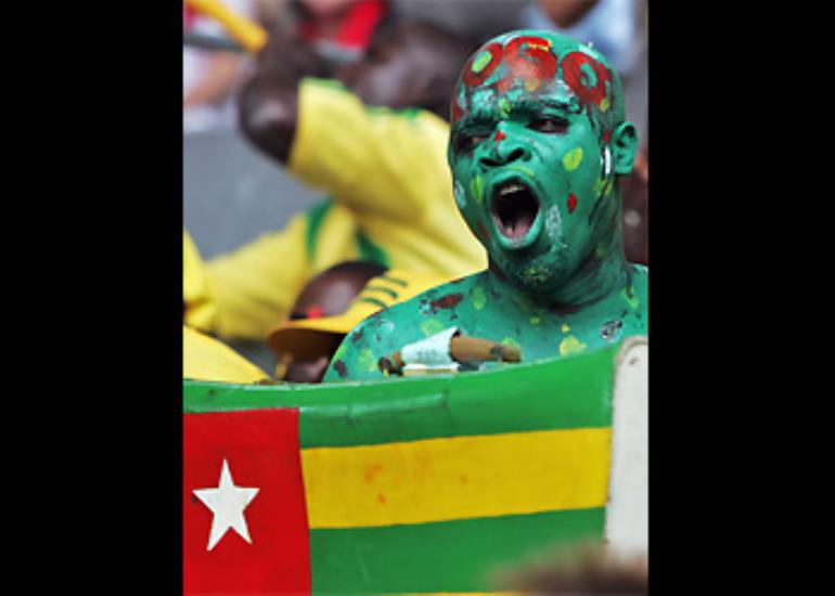 A Togo fan whips up support for his team ahead of the match with Switzerland.