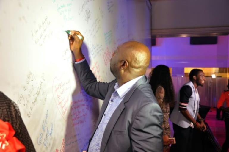 Segun Arinze Signing The Wall.jpeg