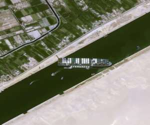 The Taiwan-run MV Ever Given container ship is lodged sideways and impeding all traffic across the Egypt's Suez Canal.  By - (Cnes2021, Distribution Airbus DS/AFP)
