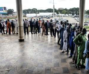Members of Guinea's civil society wait in line at the Peoples Palace ahead of talks with Colonel Mamady Doumbouya.  By JOHN WESSELS (AFP)