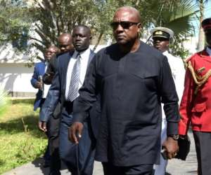 President of Ghana John Dramani Mahama (C) lost the December 7, 2016 presidential election to opposition leader Nana Akufo-Addo.  By Seyllou (AFP/File)