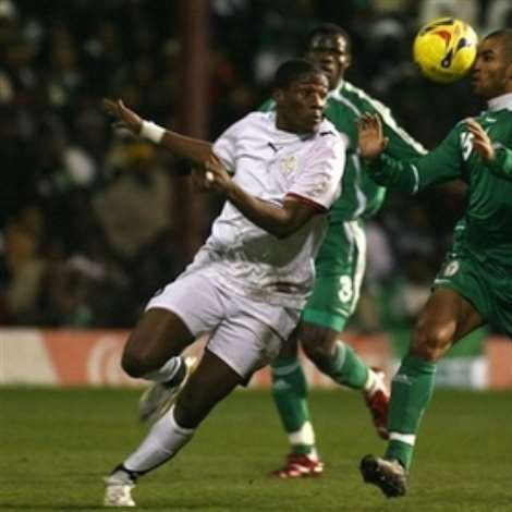 Nigeria's George Abbey, right, clears the ball away from Ghana's Asamoah Gyan during their International friendly soccer match at Griffin Park Stadium, London, Tuesday Feb. 6, 2007. (AP Photo/Graham Hughes )