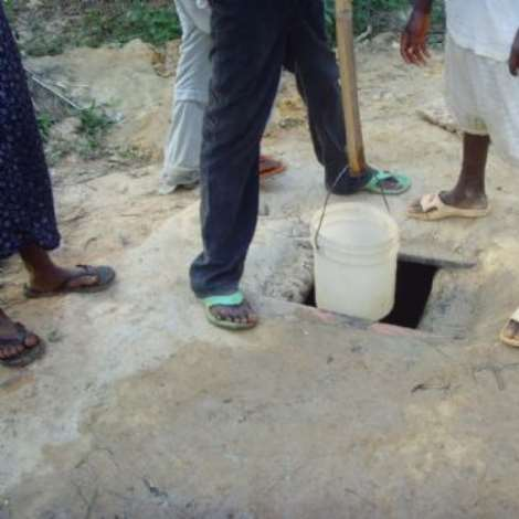 Health Threat-People of Kissi drink from holes near refuse dump