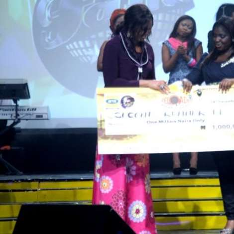 Ese receiving her prize money and car keys