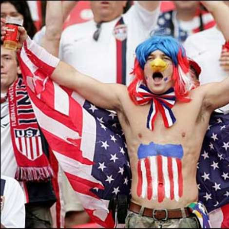 A patriotic USA fan shows his support for his team ahead of their final Group E game against Ghana in Nuremberg