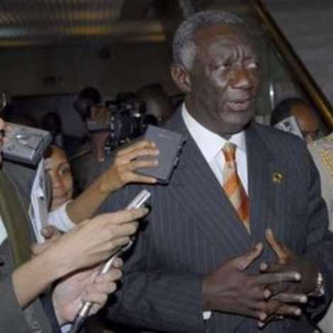 Ghana's President John Agyekum Kufuor (L), the newly elected Chairman of the African Union, speaks to the media after a closed door meeting during the African Union Summit in the United Nations office in Addis Ababa January 30, 2007. REUTERS/Andrew Heavens (ETHIOPIA)