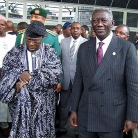 President John Kufuor of Ghana, center, leaves the 8th African Union summit as Nigerian President Olusegun Obasanjo look at his watch in Addis Ababa, Ethiopia, Monday, Jan. 29, 2007. The African Union chose Ghana to head the 53-member bloc Monday, for the second year in a row turning aside Sudan's bid because of the Darfur crisis. 'By consensus vote President (John) Kufuor of Ghana has been elected to the presidency of the African Union,' Alpha Oumar Konare, the A.U.'s chief executive, told reporters in the Ethiopian capital, Addis Ababa. (AP Photo/Les Neuhaus)