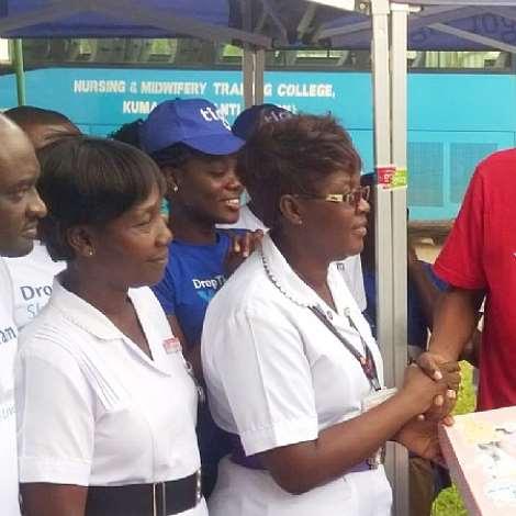 HEAD OF MARKETING FOR TIGO GHANA JESSE AGYEPONG WITH KWAW KESSE DONATING ITEMS TO KATH