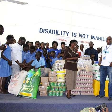 HR CONTROLLER, TIGO GHANA, DONATING TO AKROPONG SCHOOL FOR THE BLIND