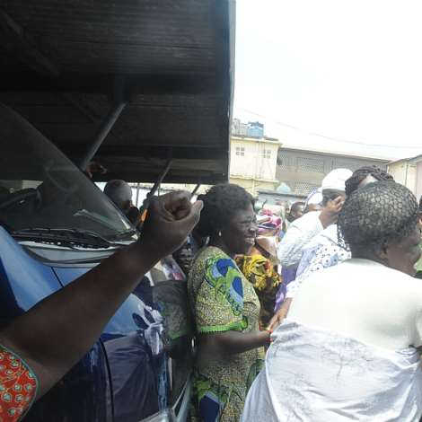 JUBILANT CROWD WELCOME NANA LORDINA TO THE USHER POLYCLINIC IN JAMES TOWN. SHE DONATED MEDICAL ITEMS TO THE POLYCLINIC.