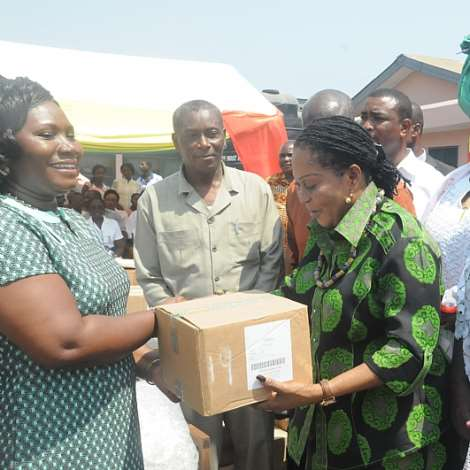 NANA LORDINA MAHAMA PRESENTING MEDICAL ITEMS TO DR LINDA VAN OTOO, GREATER ACCRA REGIONAL DIRECTOR OF HEALTH SERVICE.