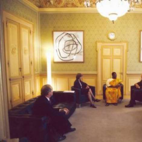 OCTOBER 19TH, 2006-H.E. Mr. Kwabena Baah-Duodu explaining a point to the Swiss Federal President, H.E. Mr. Moritz Leuenberger. Next to the Ambassador is the Federal Chancellor, Ms. Anne-Marie Huber-Hotz. At the extreme left is the Chief of Protocol at the Swiss Federal Department of Foreign Affairs, Ambassador Willy Holds. Also present are the three officers from the Ghana Embassy in Berne, who accompanied the Ambassador to the ceremony.