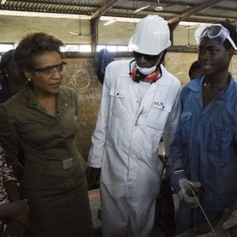 Governor General of Canada Michaelle Jean chats with workers at the Ghana regional Appropriate Technology Industrial Services in Tema, Ghana, Monday.