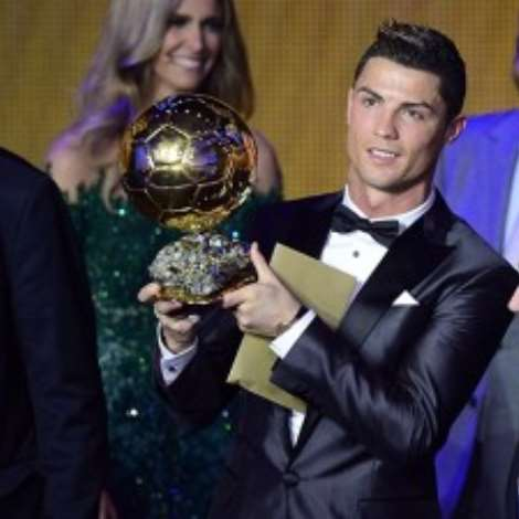 Real Madrid''s Portuguese forward Cristiano Ronaldo (C) poses with the 2013 FIFA Ballon d''Or award for player of the year next to FIFA president Sepp Blatter (R) and France Football president Francois Moriniere during the FIFA Ballon d''Or award ceremony at the Kongresshaus in Zurich on January 13, 2014. AFP PHOTO / OLIVIER MORIN (Photo credit should read OLIVIER MORIN/AFP/Getty Images)