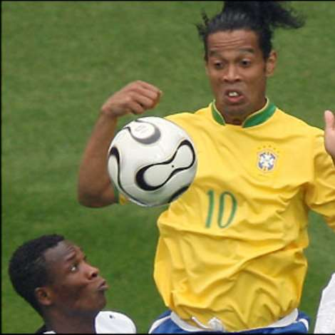 The Ghanian defence works hard to close down Brazil talisman Ronaldinho, who has a quiet game by his standards