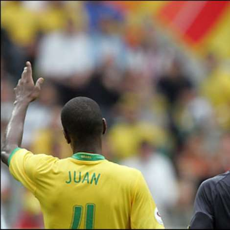 Ghana are reduced to 10 men when Asamoah Gyan is sent off for a second bookable offence following a foul on Juan