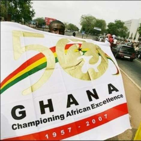 A street vendor walks with a banner featururing Ghana's Independence on the streets of the capital city Accra, 02 March 2007, ahead of the country's 50th Independence Anniversary celebrations. The first colony in sub-Saharan Africa to gain independence, Ghana will on Tuesday celebrate its 50th anniversary, sure of its own identity, but elsewhere on the continent things are not always so clear-cut.(AFP/File/Kambou Sia)