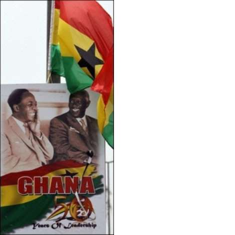 Ghanaian flag flies above a poster of the country's first president Kwame Nkruma (L) and current President John Kufuor in Accra. African leaders were pouring into the Ghanaian capital Accra ahead of 50th anniversary celebrations Tuesday of the country's independence from Britain(AFP/Kambou Sia)