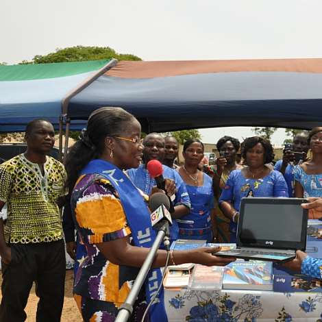 MRS. MATILDA AMISSAH-ARTHUR PRESENTS  COMPUTERS AND BOOKS TO ABOR R. C. BASIC SCHOOLS RECEIVING THE ITEMS IS THE MUNICIPAL   DIRECTOR OF EDUCATION MR.