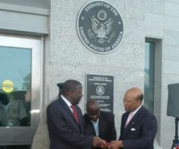 General Charles Williams, Director of US Overseas Building Operations (right) gives part of the ribbon to Ghanaian Vice President Aliu Mahama at the new US Embassy in Accra