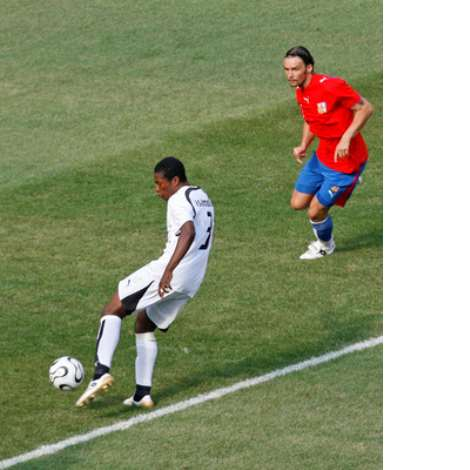 Ghana's Asamoah Gyan Scores His Team's First Goal As Czech Republic's Tomas Ujfalusi Watches During Their Group E World Cup 2006 Soccer Match In Colog