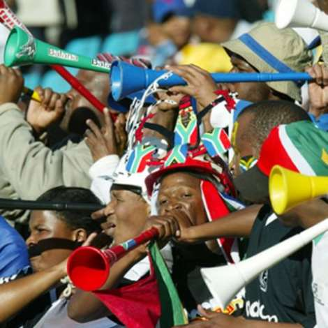 Fans with their Vuvuzelas, a plastic 'trumpet' which adds a distinctive South African sound to football games