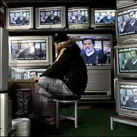 News of the execution rippled across the globe. Here a man watches television in a shop in South Korea.