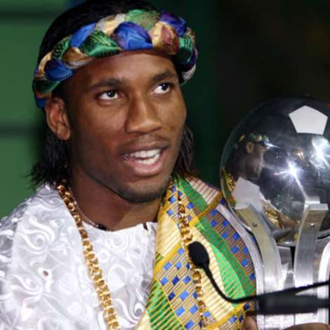Chelsea and Ivory Coast striker Didier Drogba poses with his trophy after being named African Footballer of the Year [2006] by the Confederation of African Football (CAF).