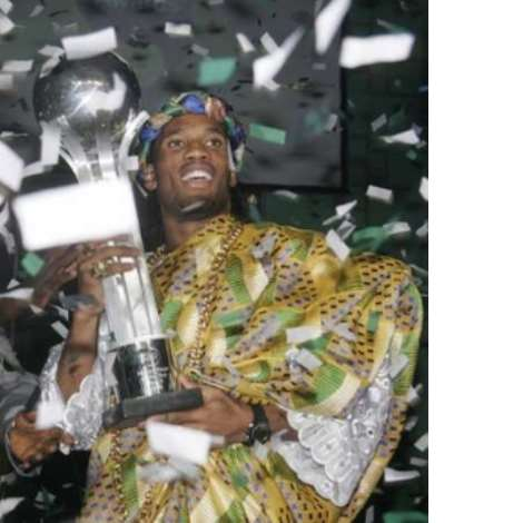 Confetti falls on soccer player Didier Drogba of Ivory Coast as he celebrates being named the African Footballer of the Year in Ghana's capital Accra March 1, 2007. REUTERS/Yaw Bibini (GHANA)