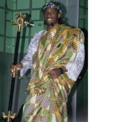 Soccer player Didier Drogba of Ivory Coast walks on stage to receive his award as the African Footballer of the Year in Ghana's capital Accra March 1, 2007. REUTERS/Yaw Bibini (GHANA)
